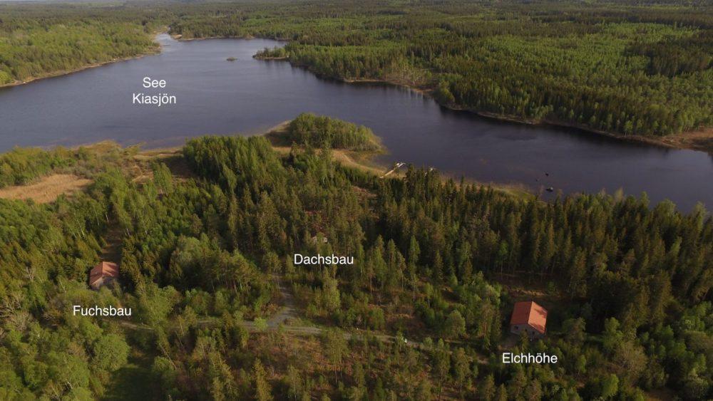 Ausläufer des Sees Kiasjön mit den neugebauten Blockhäusern