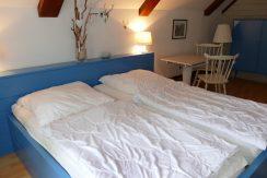 Schlafzimmer im Obergeschoss mit tollem Seeblick
