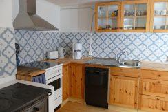 Küche im Haus Nilsson - auch mit Original-Holzherd